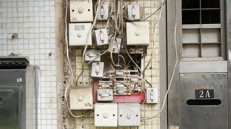 lots of switches on walls with wires running everywhere